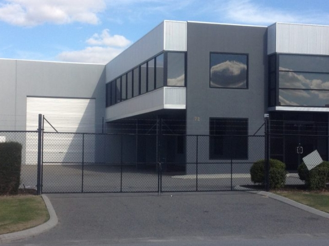 Exterior of modern warehouse/office unit, finished in shades of grey