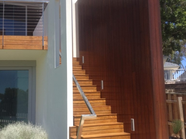 Shot of wooden exterior staircase painted in light and dark brown stain