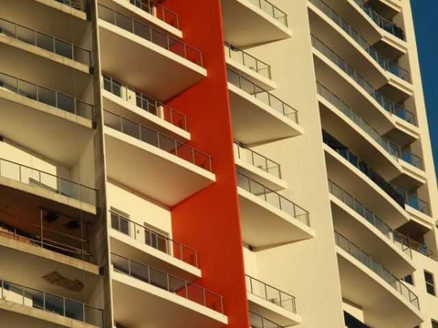 Large apartment complex painted cream and red