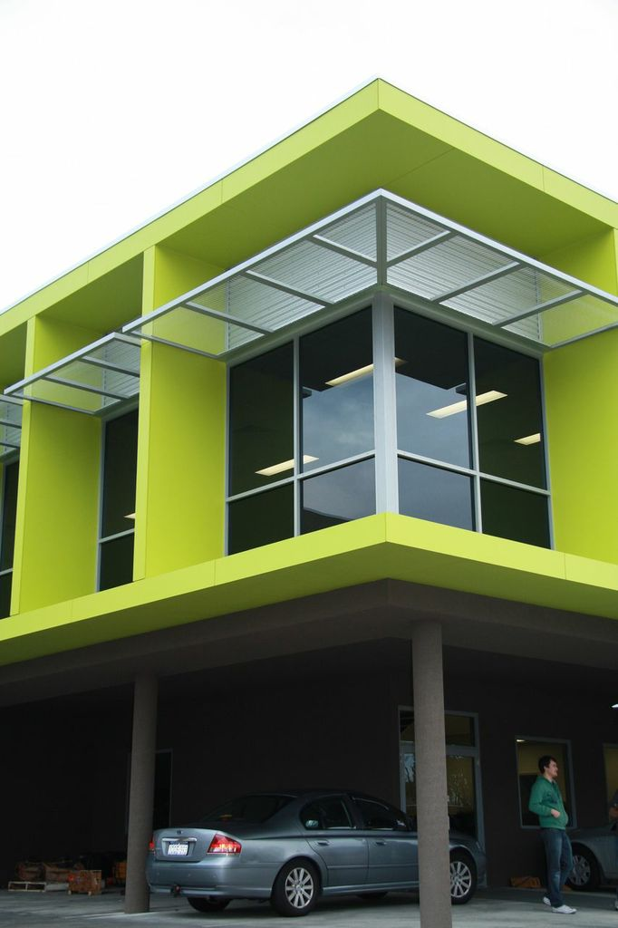 Exterior corner of commercial office block, finished in vibrant lime green
